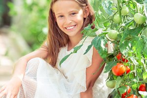 Adorable little girl harvesting cucu