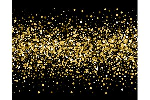 Gold sparkles on black background