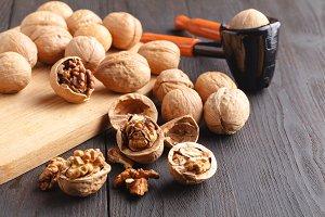 Walnuts and nutcracker on wood