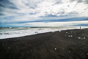 A black sand beach and sea landscape