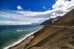 A beach, sea and mountain landscape