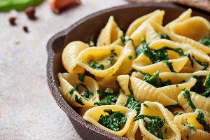 Conchiglioni pasta with spinach in