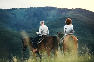 A rear view of senior couple riding