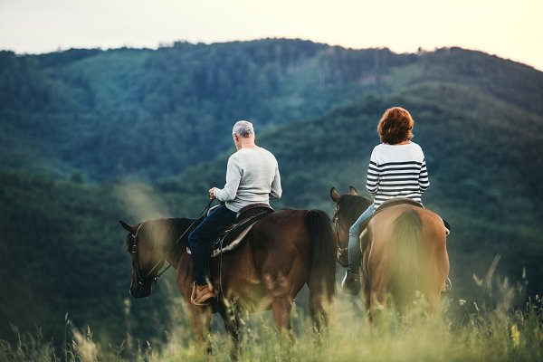 People Stock Photos: HalfPoint - A rear view of senior couple riding