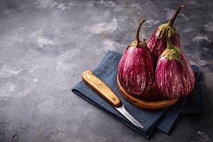 Fresh striped purple aubergines on