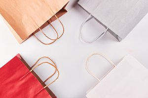 Colorful paper shopping bags on whit