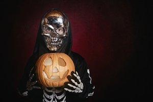 boy in skeleton costume