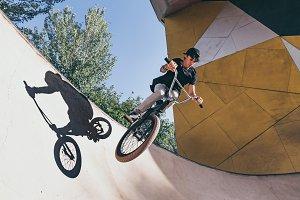 BMX rider makes a TAilwhip trick.