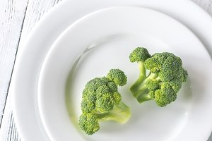 Fresh broccoli on the white plate