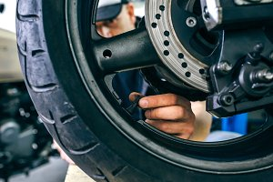 Mechanic placing motorcycle wheel va