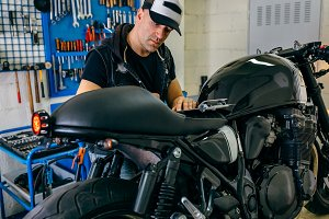 Mechanic checking motorcycle