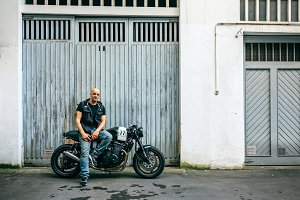 Biker posing with a motorcycle