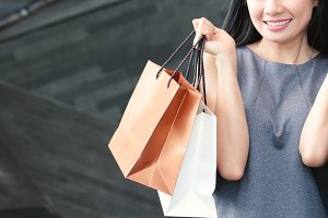 Asian happy woman with shopping bags