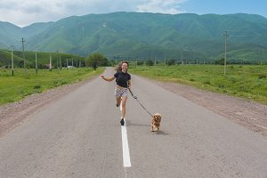Young beautiful woman walking with