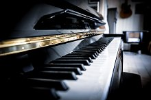Black piano by  in Arts & Entertainment