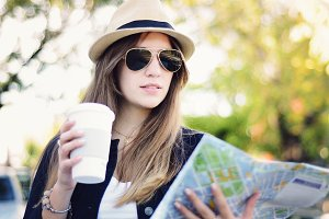Young tourist woman with coffee look