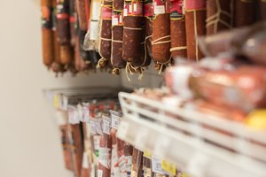 Smoked sausages on the shelf in the