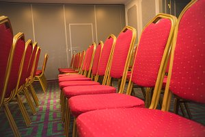 Row of red soft chairs in a