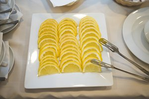 Lemon slices in a square plate on