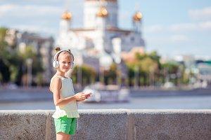 Little adorable girl listening music