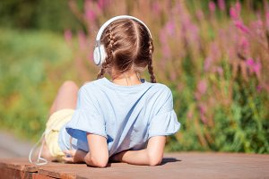 Little adorable girl listening music