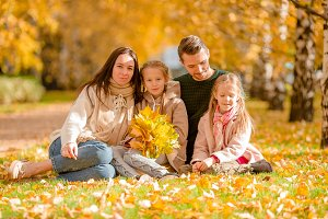 Portrait of happy family of four in