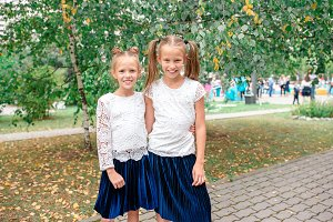 Two cute smilling little girls posin
