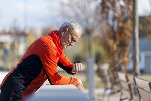 An Active jogging senior looking his