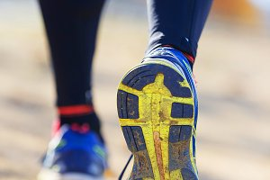 Athlete runner feet running in natur
