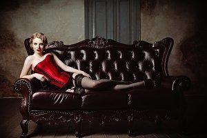 Sexy young woman on sofa. Retro