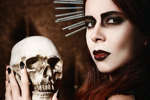 Beautiful gothic girl with skull