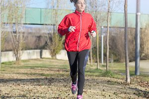 Active and sporty woman runner in au