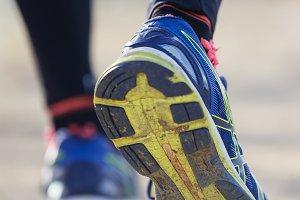 Runner Man Feet Running on Road clos