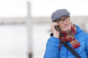 Senior Man Talking on Mobile Phone i