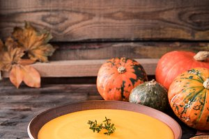 Pumpkin puree soup with thyme on a d