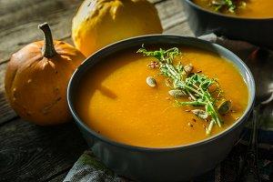 Pumpkin soup with pea micro green