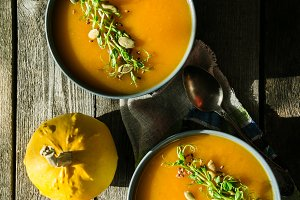 Pumpkin soup with pea micro green