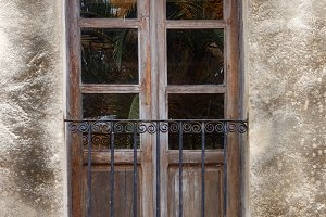 Old door of a balcony with iron rail