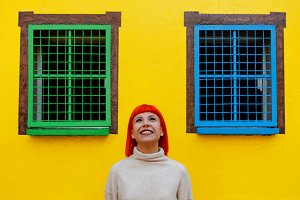 Attractive girl over a yellow house