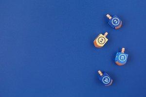 Multicolor dreidels on dark blue