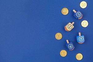 Hanukkah theme with dreidels & coins