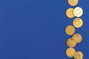 Dark blue background with coins