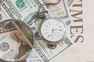 Pocket clock, American dollars and m