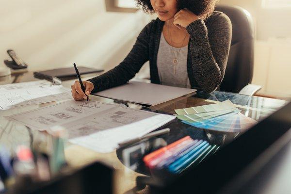 Female architect working new design…