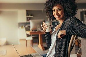 African woman taking coffee break
