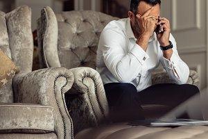 Stressed businessman talking