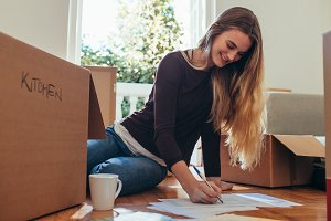 Smiling woman sitting with packing