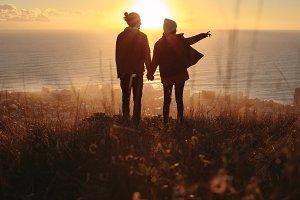 Traveling couple overlooking the sea