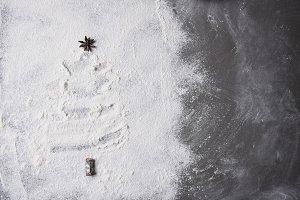 Christmas tree shape in flour spread