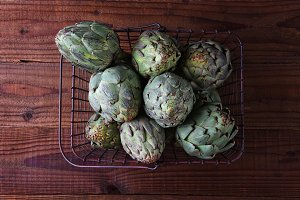 Artichokes filling a metal shopping
